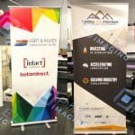 Two retractable banner stands holding custom-printed banners