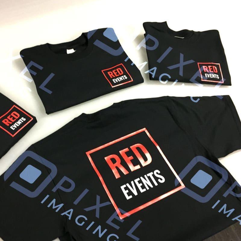 Custom-printed vinyl-transfer T-shirts featuring company logos.