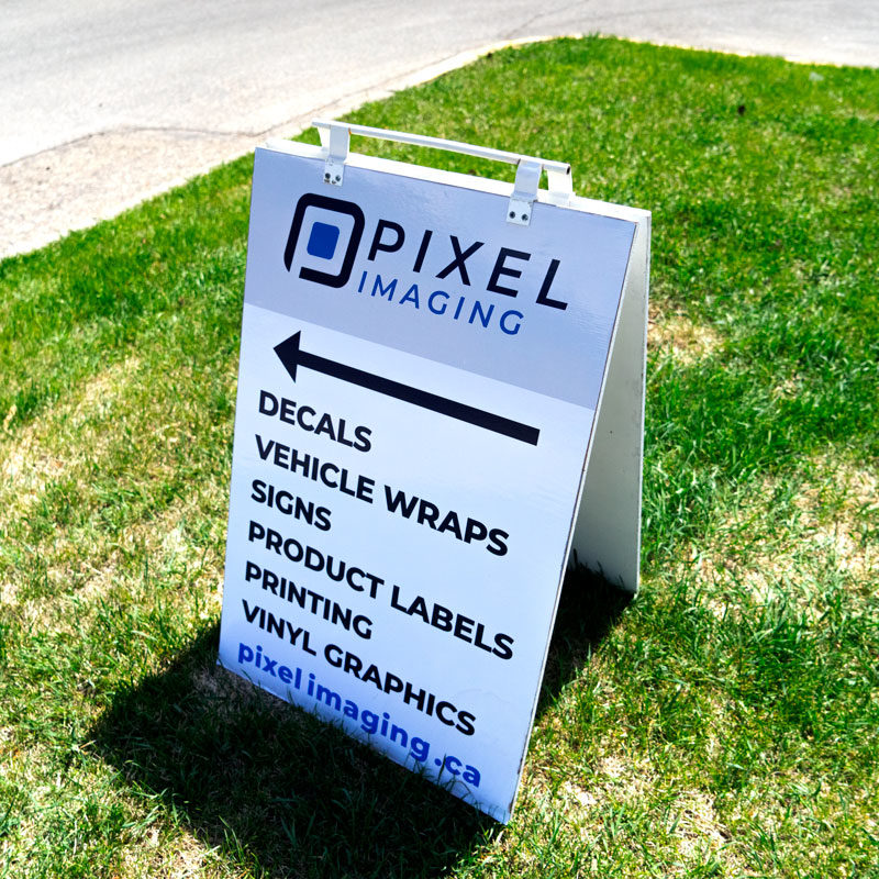 A sandwich board marketing a business, featuring the business logo, website, and a list of services it provides